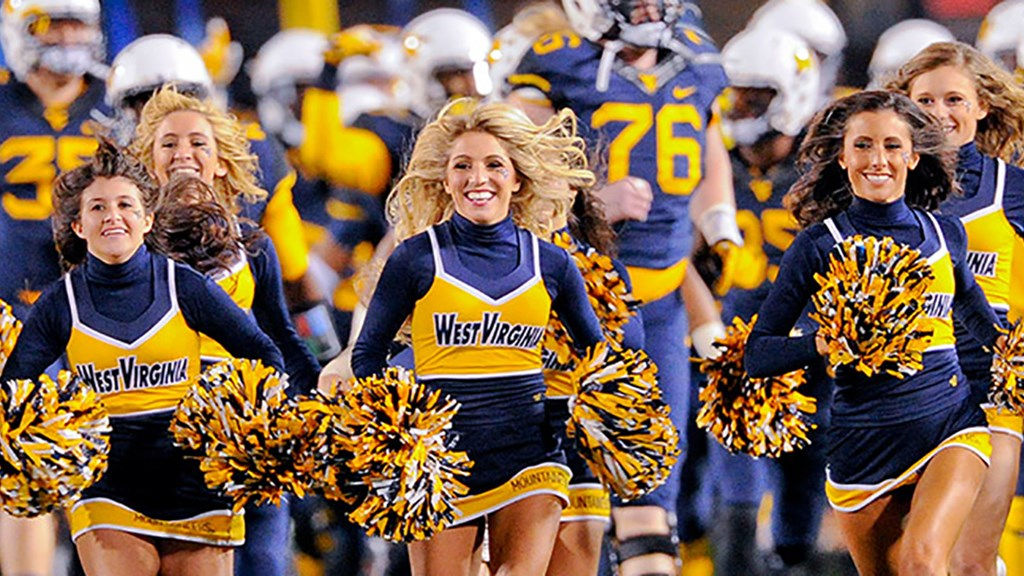 The WVU cheer team cheering at a football game